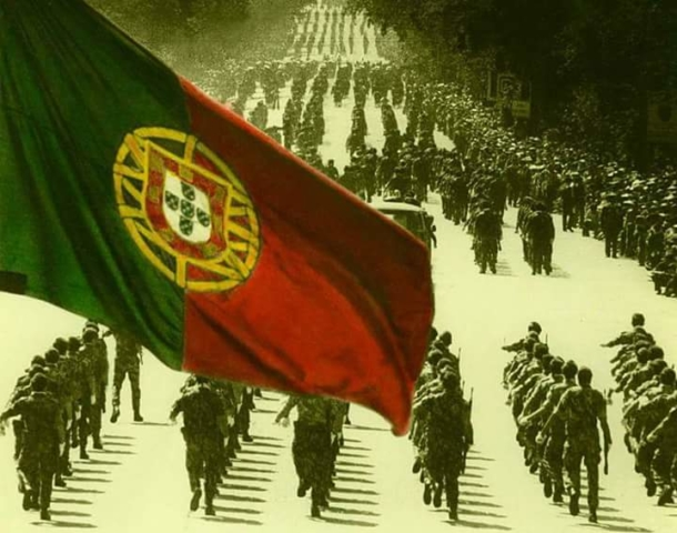 photo showing a parade of troops with Portuguese flag