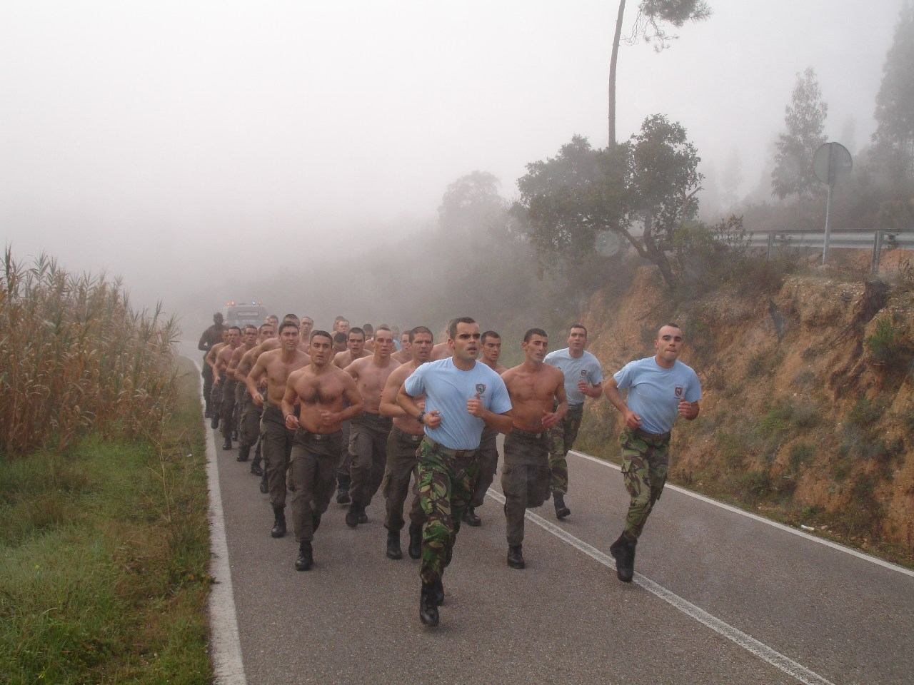 a platoon running in formation in the street