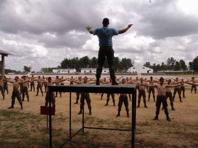 A group of troops performing weightless exercises